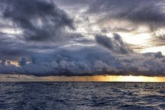 Sunset squall - outside the reef @ Bora Bora, Polynesie Francaise (Timothy Hastings) Tags: ocean sea water sunset waves squall storm rain clouds small yellow tint outdoors polynesia french