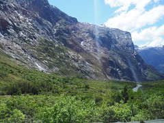 Fiordland National Park, ascent from Milford Sound to Homer Tunnel New Zealand (Kalpesh Patel.) Tags: milfordsound newzealand southisland homertunnel road natural outstanding beauty epic magic surreal massive fiordland fiordlandnationalpark mountain rockface sky cloud breathtaking glacier snow ice firest bush wildlife flora fauna nature keabird waterfall stream divine inspiration mystical light shadow