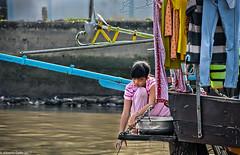 The Girl with a Bucket (albertlondon) Tags: vietnam mekongriver fishermen fishingvillage halongbay saigon hanoi boats fishing