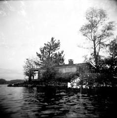 10.2016 LLWM Holga SFX BW Kayaking E0009 (Jcicely) Tags: 2016 bwfilm cabin doubleexposure holga kayaking lake loonlake loonlakewithmarvin october trees water