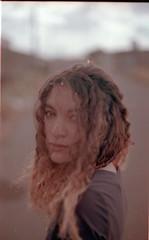 Poēm of a face. (Gabriel Plcs) Tags: 35mmfilm argentique analogue analog analogico filmphotography 50mm f14 cplfilter portrait retrato kodak proimage asa100 strase rue dof mood underexposed melancholy spring