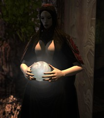In our hands we see what may be (alexandriabrangwin) Tags: alexandriabrangwin secondlife 3d cgi computer graphics virtual world photography statue gypsy seer sorcerer wise woman crystal ball globe glowing holding seeing future mystical dark energy camp tent forest wilderness secret