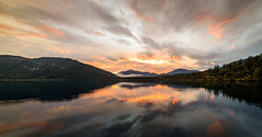 Where fire and water do mix (ajecaldwell11) Tags: sunrise ankh newzealand water reflection sky clouds dawn caldwell lakeparinga light