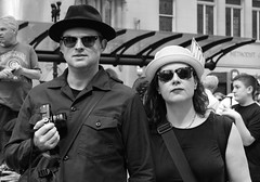 Tax Day Protest - Chicago - 15 Apr 2017 - 058 copy (Andre's Street Photography) Tags: taxdayprotestchicago15apr2017 monochrome bw bwphotography blackandwhite portrait streetportrait straatportret straatfotografie streetphotography candid strangers couple man woman hats shades sunglasses americangothic demonstration trumptaxprotest chicago downtown loop zwartwit noiretblanc blancoynegro canon eos 7dmarkii ef50mmstm 50mm prime primelens standard lens apsc protest daleyplaza picassoplaza people urban city illinois midwest cookcounty chicagoist chicagojournal chicagotribune chicagoreader chicagomagazine bwphoto photobyandrevanvegten