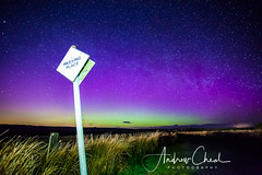 Passing Place (Andrew Cheal) Tags: aurora borealis night northernlights purple green passing place sign signpost greenhead northumberland