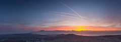 Irelands East coast, panorama (Whhhere's Johnny) Tags: light sun mountains water sea sunrise cloud spring morning landscape seascape golden hour orange red pink tokina 1116