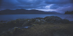 Night Falls (Lynleigh Cooper) Tags: scotland scottishhighlands scottish scenery scenic vista visitscotland beauty beautiful beautyinnature lake water sky clouds dusk dark mountains mountain mountainphotography landscape landscapephotography landscapes travel traveler adventure wanderer world fineartphotography lookslikefilm vsco bluehour wideangledlens wideangle nikon nikond750 d750 fullframe colorful contrast moody mood natureshot light europe neutraldensity neutraldensityfilter loch unitedkingdom winter evening