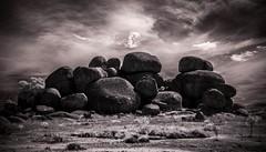 Here for the duration. (erglis_m (Mick)) Tags: blackandwhite bw ir blackwhite interesting rocks desert nt dirt infrared dust rockformations infraredfilter stuarthighway theoutback tanami thedevilsmarbles karlukarlu