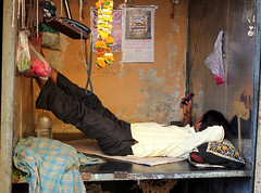Relaxing at Work (cowyeow) Tags: street city india shop store funny candid indian working lazy bombay resting mumbai job shopfront owner streetmarket texting feetup colaba buisness funnyindia