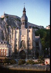 Dinant is a city in Belgium's Walloon Region. It's on the banks of the Meuse River and backed by steep cliffs.  1985 001 (photographer695) Tags: dinant is city belgium's walloon region it's banks meuse river backed by steep cliffs 1985