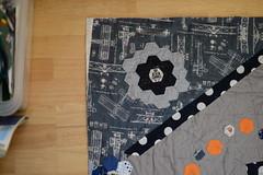 Cyberman and blueprint front top left corner DSC_0025 (2) (nearlybutnotquite) Tags: boy quilt geek handmade cupcake handsewn hexagons dots patchwork epp cyberman dotty basting appliqu handquilted englishpaperpiecing nearlybutnotquite nbnq nbnqnbnq