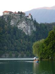 Castle Over Boat in Lake Bled (Michael R Perry) Tags: slovenia slovenija triglav triglavnationalpark triglavskinarodnipark triglavski