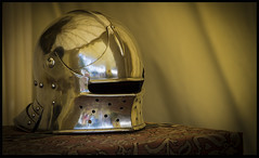 Resting Knhight's helmet (Tony West 2009) Tags: reflection castle leather metal silver gold shiny hand medieval knight armour reenactment herstmonceux
