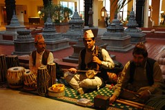 Nepalese band, traditional music, tabla (drums), violin (Calles sarangi), flutes (bansuri), Tibetan Buddhist style stupas in the background (marble), lobby, Hyatt Regency Boudha, Kathmandu, Nepal (Wonderlane) Tags: nepal musicians religious path buddhist traditional religion buddhism lobby violin tibetan kathmandu tradition spiritual enlightenment result flutes initiation boudha traditionalmusic empowerment tibetanbuddhist 5083 lamdre hyattregencyboudha nepalesemusic tabladrums nepaleseband tibetanbuddhiststylestupasinthebackgroundmarble tibetanbuddhiststylestupas