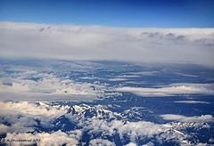 Flying over the Cascade Mountains in Washington State (PhotosToArtByMike) Tags: mountains window airplane volcano washington aerialview wa washingtonstate cascademountains cascaderange airplaneview