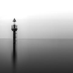 Beacon of Light (- Etude -) Tags: light sea white seascape black water monochrome square singapore smooth olympus minimal nd boardwalk changi beacon minimalist hitech omd