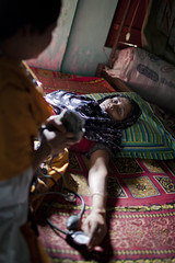 A pregnant woman Ruman Khanom has a general check up from a BRAC community nurse.