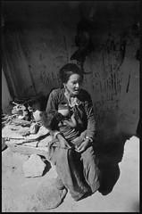Feeding time (chinese johnny) Tags: nepal portrait bw expedition analog minoltax700 research 35mmfilm himalayan leicam6 villagelife scannednegative earthwatch bwfilm documentaryphotography trixfilm jumla earthwatchresearchexpedition dorbista tirkhu chaudabisavalley