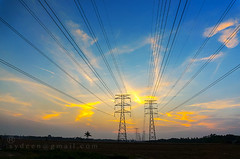 dramatic sunset (sydeen) Tags: blue sunset sky orange plant black tower industry lines silhouette yellow electric metal danger sunrise landscape grid high wire energy industrial technology power dusk steel towers engineering nobody cable structure line pole pylon electricity tall electrical transmission voltage