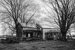 Depression era home (I saw_that) Tags: black white desolate blakandwhite abandonned ruin monochrome spring destroyed housefarm farmhouse country coutryside rural tractor wreck old trees new york state highway 37 uncool cool cool2 cool3 uncool2 uncool3 cool4 uncool4 uncool5 uncool6 uncool7 iceboxuncool