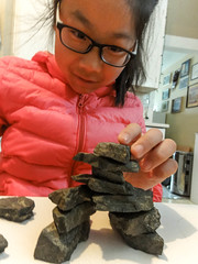 Getting the balance just right (Canadian Dragon) Tags: 2017 bc canada chinese dschx5c february nanaimo vancouverisland balance concentrate concentration girls inukshuk learn learning make play playing rocks stack stones winter