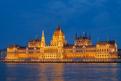 Hungarian Parliament (Luca Quadrio) Tags: ancient parliament place historic budapest monument city riverside government illuminated symmetry twilight architecture gothic downtown night bluehour magyar danube symbol old european landmark facade outdoor dusk evening fujifilm light culture exterior blue hungarian hungary beautiful travel building cupola history sightseeing architectural nighttime europe urban sky