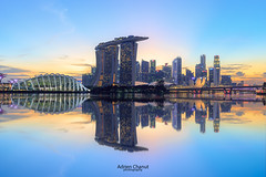 Singapore Skyline (AdrienC.) Tags: singapore sykline travel asia skyscraper reflexion water clouds colors architecture modern city color marina bay skypark buildings building tower