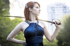 Wonder Women - Becki (5) (FightGuy Photography) Tags: becki bluedress crystalcity naturallight va strobist saber weapon blade sword redhead pale cheekbones sunset