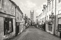 """The Church of St Michael the Greater in Stamford. UK. (""""DavidJHiom"""") Tags: stamford church lincolnshire ancient monochrome street cobble cobblestones davidjhiom davomphotography stmichaells thechurchofstmichaelthegreaterinstamford saarlysqualityp{ictures"""