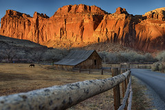 Love does not consist in gazing at each other, but in looking outward together in the same direction… (ferpectshotz) Tags: fruitabarn giffordfarm capitolreef nationalpark utah sunset barn scenicdrive oasis desert rustic farm fence