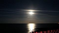 Moon Shine (bimbler2009) Tags: fujifilms9900w noflashnightshot moon luna sea water ocean sky cloud red light illumination movement motion explore