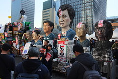 "Seoul Korea Kwanghwamun candle rally March 11 2017 featuring row of effigies - ""The Rogues' Gallery"" (moreska) Tags: seoul korea kwanghwamun candle rally march 11 2017 democracy freespeech effigy satire impeachment bound photoops socialchange unstaged candid signs slogans placard politicalart humor crowd plaza afternoon statue buildings 광화문 capital 대한민국 rok asia"