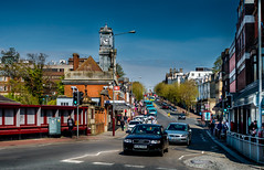 A little bit of Tunbridge Wells (aquanout) Tags: cars bus taxi people railwaystation colourful buildings clock trees road town kent england