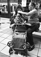 Her grandmom does her hair (goofcitygoof) Tags: picmonkey strollers septa broadstreetline bsl