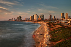 Golden Tel Aviv (Xenedis) Tags: city sea sky beach water skyline clouds buildings israel telaviv cityscape middleeast jaffa goldenhour mediterraneansea yafo stateofisrael