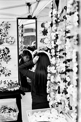 Reflection (kuronakko) Tags: sanfrancisco street flowers blackandwhite reflection film glass girl hair photography mirror exercise cityhall iso400 leicam5 aristapremium400 blackandwhitefilmphotography bwfp leicasummiluxm50mmf14e46preasphlens