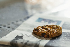 Cookie! (Johhnnyyv) Tags: food film canon 50mm newspaper cookie grain snack noise