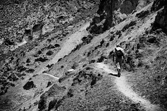 Keep Walking (Spyros Papaspyropoulos) Tags: street morning light blackandwhite bw man mountains monochrome trekking 35mm walking mono rocks day shadows hiking path walk candid streetphotography hills greece walker