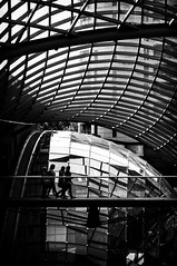 Walk on Glass (hoopsci) Tags: street uk bridge roof girls england people reflection window glass monochrome lines silhouette mall bristol nikon curves structure reflect sphere walkway metalwork panels curve shape blackdiamond struts sweeping d5000 cabotcircus