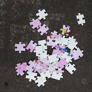 Puzzle pieces on the sidewalk