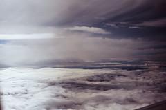 final desent. (Olivia La Roche) Tags: above sky mountains film plane fly fuji minolta couds cloudporn milehigh x700
