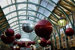 Xmas balls (raindog) Tags: christmas xmas decorations london fuji twinkle sparkle lensflare coventgarden x100s