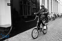 Joying the ride. (DwayneMaikel Photography ) Tags: street camera city summer portrait people streetart closeup canon photography photo child close streetphotography samsung s photograph dm zwolle straat straatfotografie strobist canon60d samsungnx300 dmfotografiezwolle