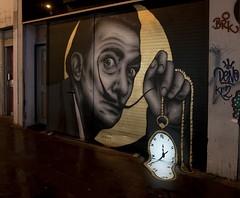 Salvador Dali by Zabou (nolionsinengland) Tags: streetart shoreditch shutter salvadordali watch surreal surrealism nightphotography nightstreetart pocketwatch ticktock moustache