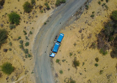 Aerial view of a truck overturned on a mountain road, Omo Valley, Konso, Ethiopia (Eric Lafforgue) Tags: above accident aerial aerialview africa blue colourpicture crash day daytime drone elevated ethdrone031750 ethiopia highangle horizontal hornofafrica konso nopeople nobody outdoors overturned overview perspective pil road truck truckcrash vehicleaccident view omovalley et