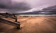 Shifting sands. (AlbOst) Tags: sea seaside sand groynes windy cloudy stormy stormclouds lossiemouth moray blowing woodenstructures greatphotographers