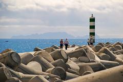 Walk me to the glittering water (Basse911) Tags: atlanticocean happycouple breakwater funchal madeira