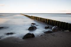 Breakwater (_Cornucopia_) Tags: beach water longexposure balticsea ostsee bulb breakwater redewisch rocks sand sunset