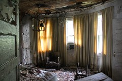 Probably originally intended as the dining room, this first-floor space was being used as a bedroom. (seventh_sense) Tags: abandoned ruins decay house deserted home homestead porch overgrown field overgrowth brambles weathered derelict decayed decaying rotting fire damage damaged destroyed burned charred collapse collapsed collapsing victorian garrison owings mills maryland firedamaged