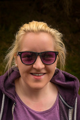 A warm smile and such cool shades! (grahamrobb888) Tags: nikon nikond800 nikkor50mmf18 polarised polariser filter birnamwood birnam perthshire scotland purple smile smiling smilinggirl shades sunglasses directgaze